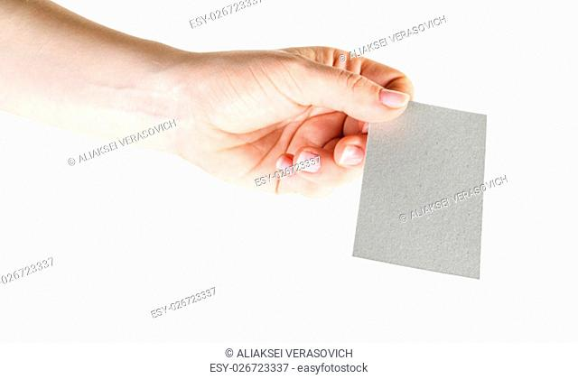 Photo of blank business card in hand isolated with clipping path on white background. Mock-up for design presentations and portfolios