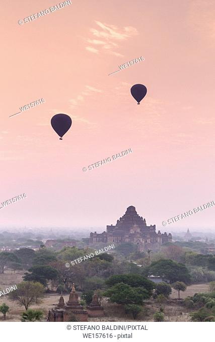 Hot air balloons floating over Bagan temples at sunrise, Bagan, Myanmar