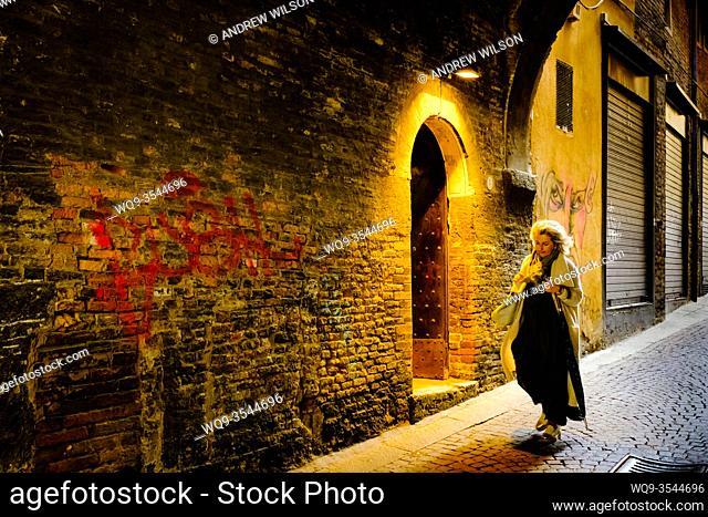 An interesting doorway in the Via de' Foscherari - a cobbled street in old Bologna, Italy