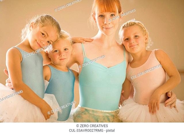 Ballet teacher standing with students