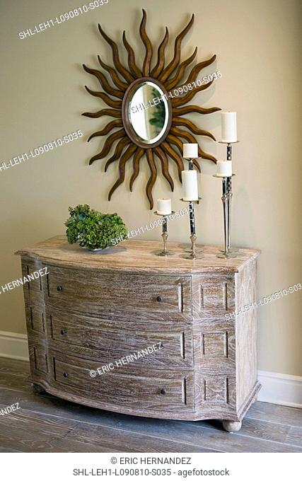 Wooden three drawer dresser with candle collection on top