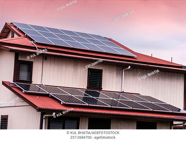 Solar panels on two levels of a house, the Big Island, Hawaii, USA