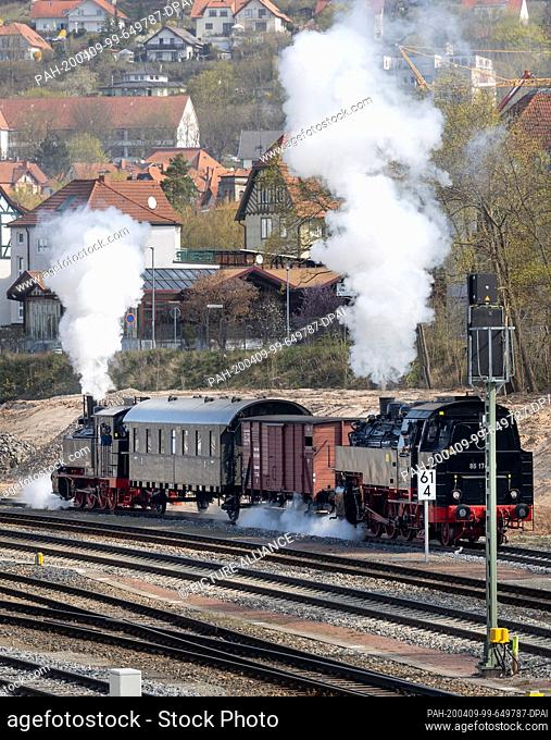 09 April 2020, Thuringia, Meiningen: The newly repaired steam locomotive 99 886 (l) of the Rhön train, which was severely damaged in an accident in the summer...