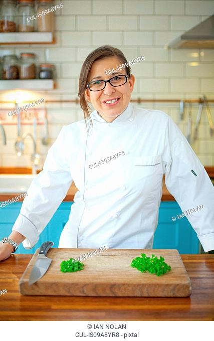 Portrait of female chef in commercial kitchen