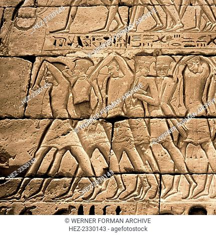 Relief from the temple of Ramesses III at Medinet Habu, Egypt, c1187-1156 BC. Detail showing Philistines in feathered headdresses being led away by Egyptians