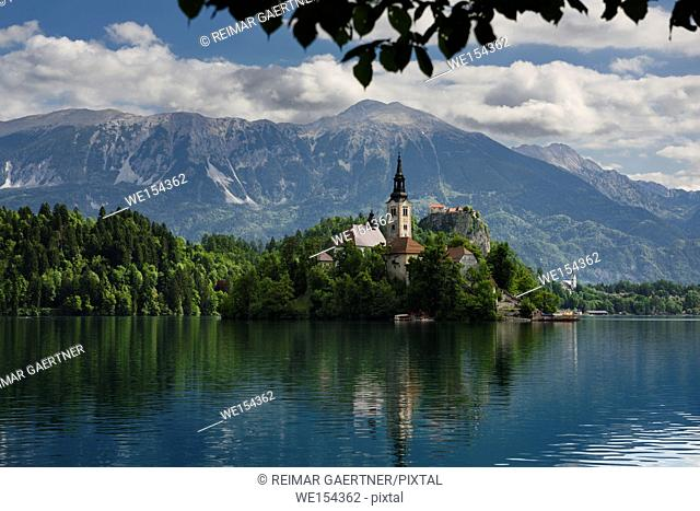 Assumption of Mary pilgrimage church on Bled Island Bled castle on Lake Bled with Vajnez and Veliki Stol Karawanks mountains Bled Slovenia