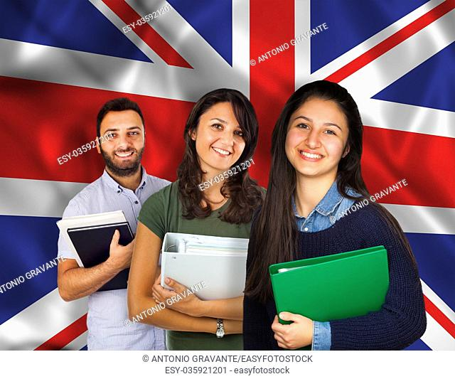 Couple of young students with books over United Kingdom flag