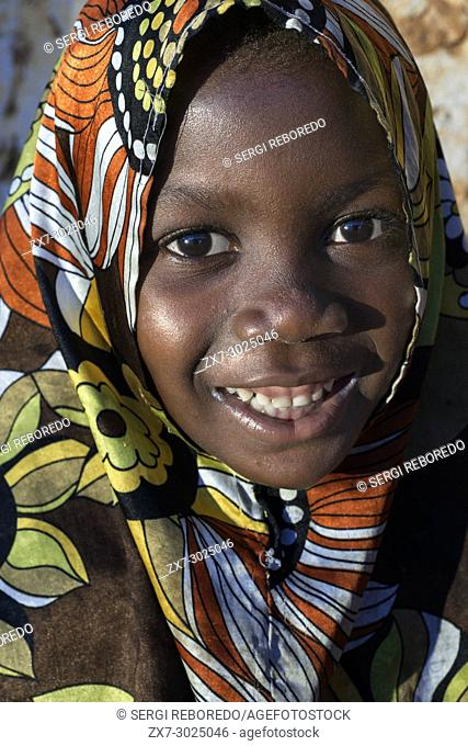 Young girl dressed with full color clothing in Kizimkazi Dimbani village, West coast, Zanzibar, Tanzania