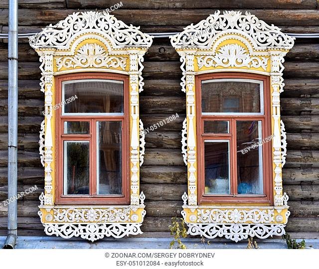 Wooden decorating of windows of old residential buildings