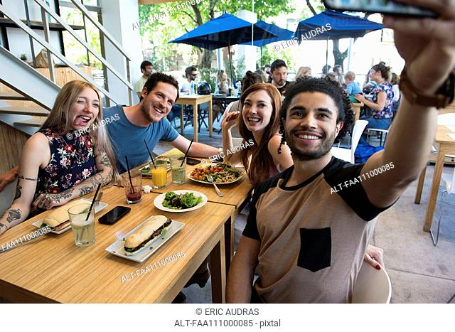 Man taking selfie with friends