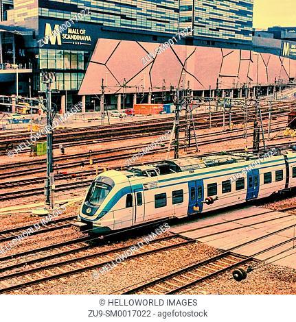 Multiple railway lines passing the Mall of Scandinavia, Solna, Stockholm, Sweden, Scandinavia