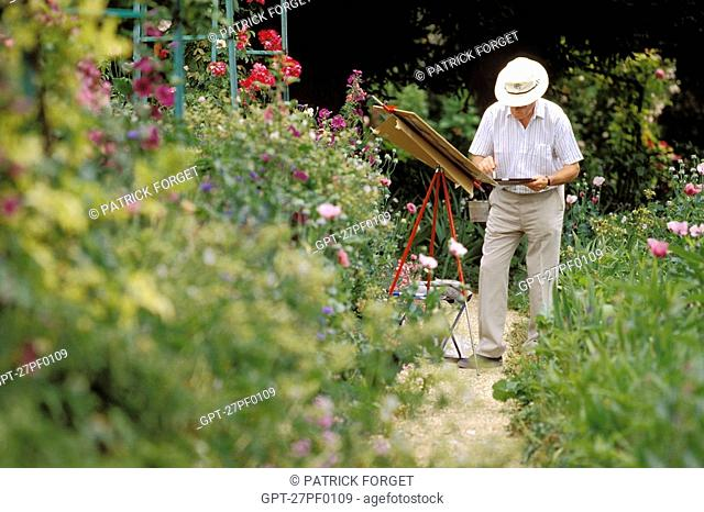 PAINTER IN CLAUDE MONET'S GARDEN, GIVERNY, EURE 27, NORMANDY, FRANCE