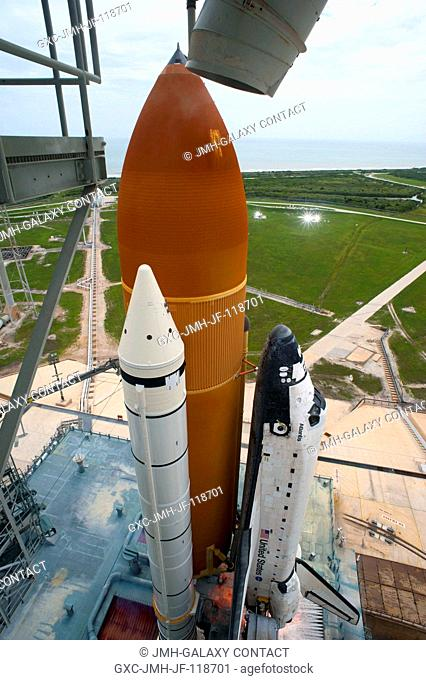 Space shuttle Atlantis, secured atop a mobile launcher platform, is moments from liftoff from Launch Pad 39A, overlooking the Atlantic Ocean at NASA's Kennedy...