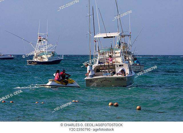 Jet Ski Taxiing Passengers from Shore to their Boats. Playa del Carmen, Riviera Maya, Yucatan, Mexico