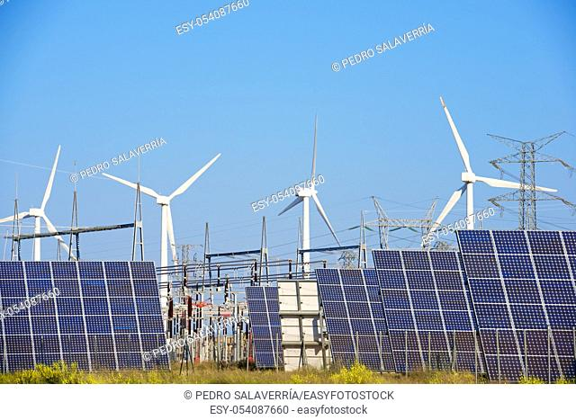 Windmills and photovoltaic panels for energy production, Navarra, Spain