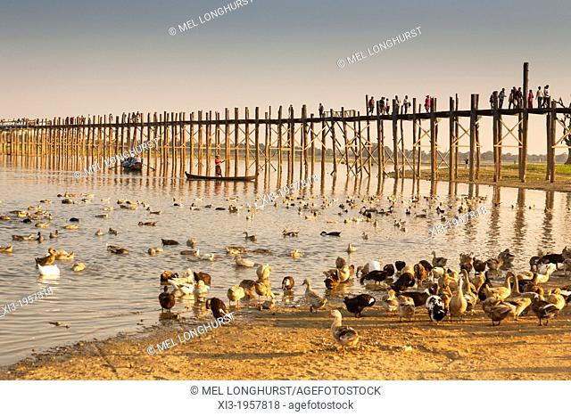 U Bein wooden bridge, world's longest teak footbridge, crossing Taungthaman Lake, Amarapura, Mandalay, Myanmar, (Burma)