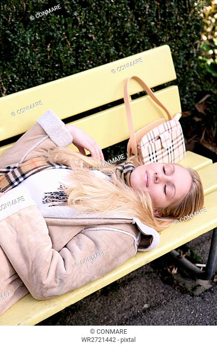 woman, lying, bench, park, relaxed, smiling, femal
