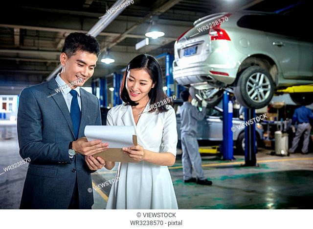 Car sales staff and customers