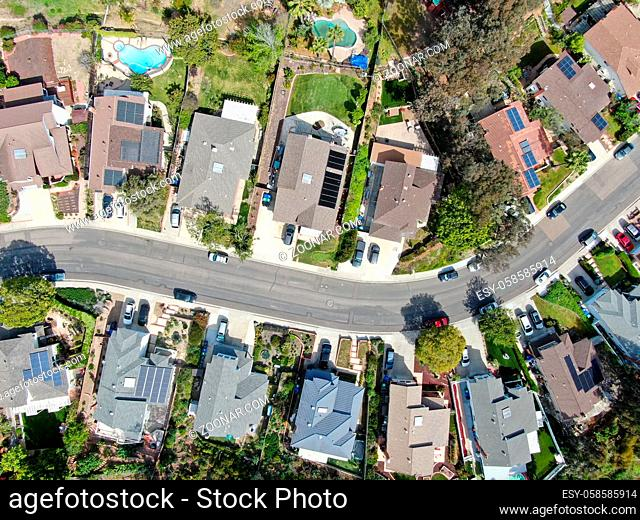 Aerial top view of upper middle class neighborhood street with residential house and swimming pool in San Diego, California, USA