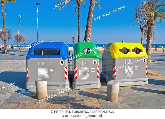 Recycling bins at Platja de Sant Sebastia beach Barcelona Catalunya Spain Europe
