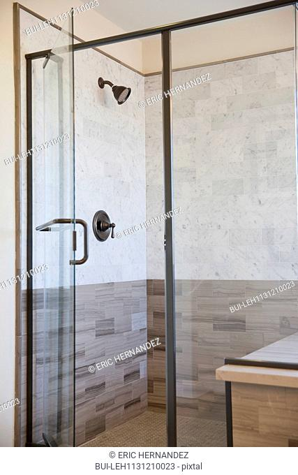 View of glass shower in bathroom at home