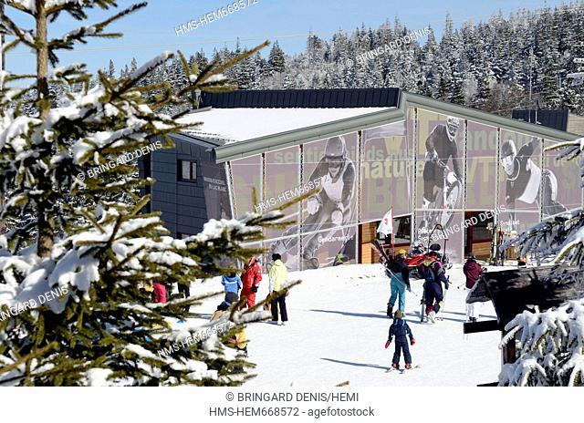 France, Haut Rhin, Hautes Vosges, Col du Calvaire, Lac Blanc, ski resort, skiers in front of the Lac Blanc Reception, winter, snow