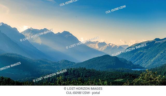 Morning sun rays in an alpine valley, San Bernadino Pass, Canton Graubunden, Switzerland