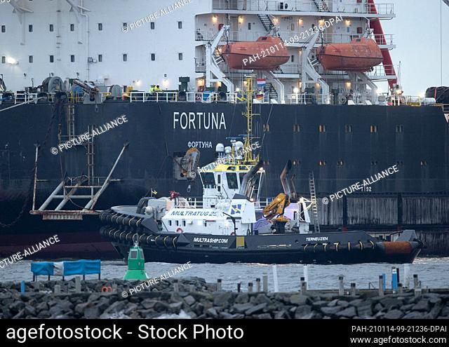 """14 January 2021, Mecklenburg-Western Pomerania, Wismar: Tugboats get into position on the Russian pipe-laying vessel """"""""Fortuna"""""""" in the port"""