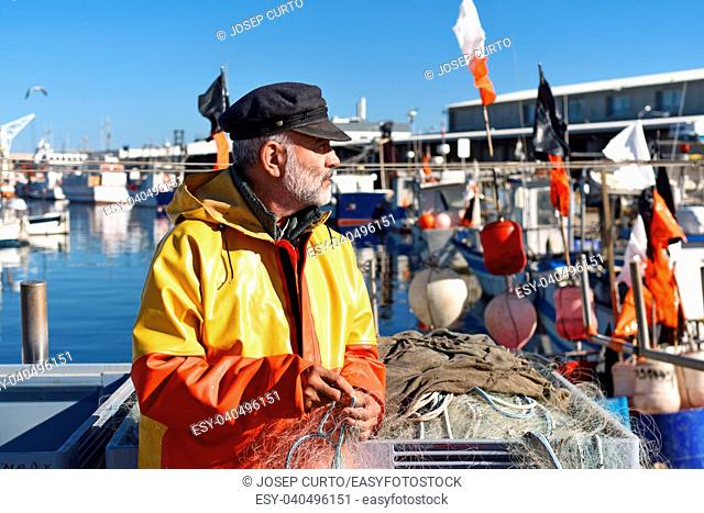 fisherman in the fishing port of Escala, Costa Brava, Girona province, Spain