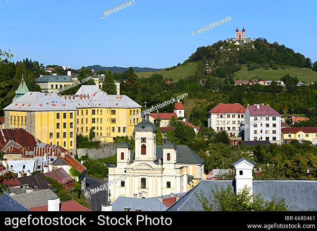 View over the town, in the middle the Church of the Assumption of the Virgin Mary and in the back the Calvary, Banska Stiavnica or Schemnitz or Schebnitz