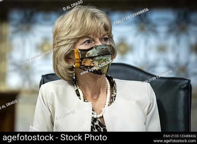 United States Senator Lisa Murkowski (Republican of Alaska), wears a protective covering during a Senate Health, Education