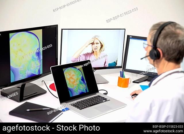 A young woman having a video consultation with a male GP for head pain with brain imagery