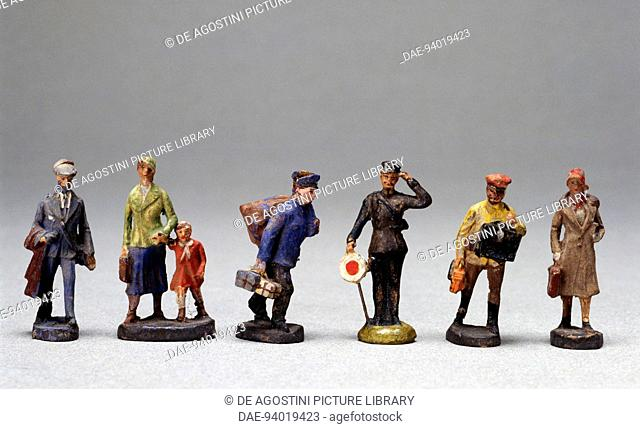 Train station figures, painted papier-mache toys, made by Elastolin for Marklin, 1936. Germany, 20th century.  Milan, Museo Del Giocattolo E Del Bambino (Toys...