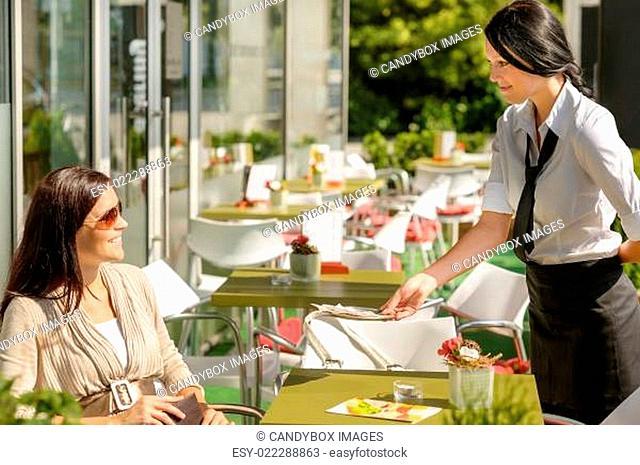 Waitress give back change bill restaurant terrace