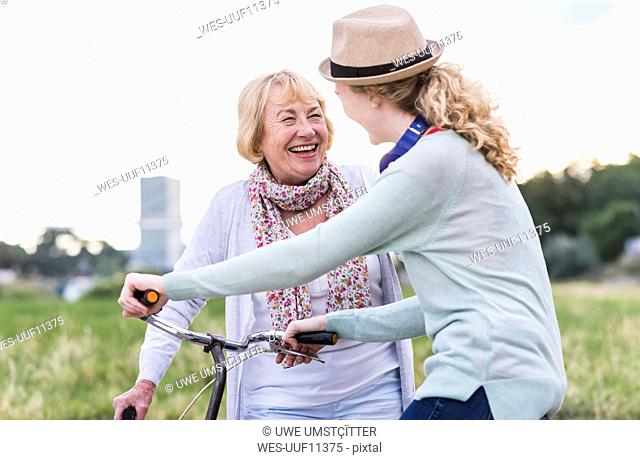 Grandmother and granddaughter having fun together