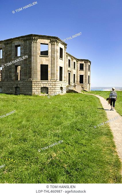 Northern Ireland, County Londonderry, Coleraine, A woman walking along a path leading to the remains of Downhill House