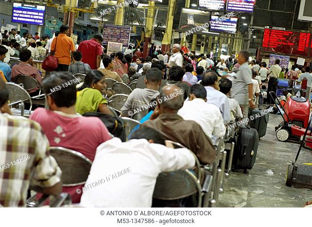 Cheenai, India - April 28, 2010: large number of travelers waiting seated in the main departure waiting wall of Cennai Central Railways station