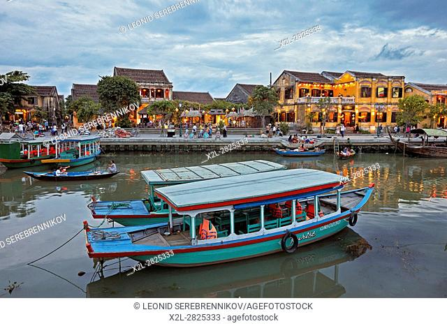 Traditional boats on the Thu Bon river at dusk. Hoi An Ancient Town, Quang Nam Province, Vietnam