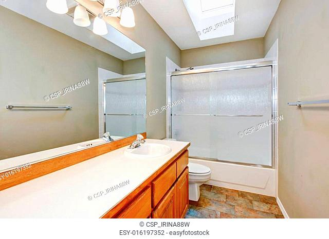 New empty bathroom with wood countertops and beige walls