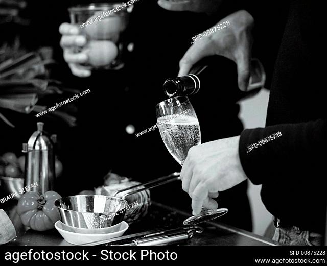 Pouring a glass of sparkling wine