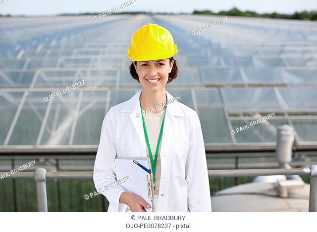 Scientist standing on roof of building