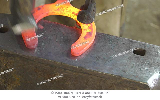 farrier shape hot horseshoes