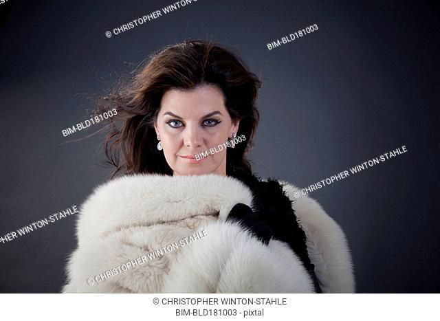 Caucasian woman wearing fur coat
