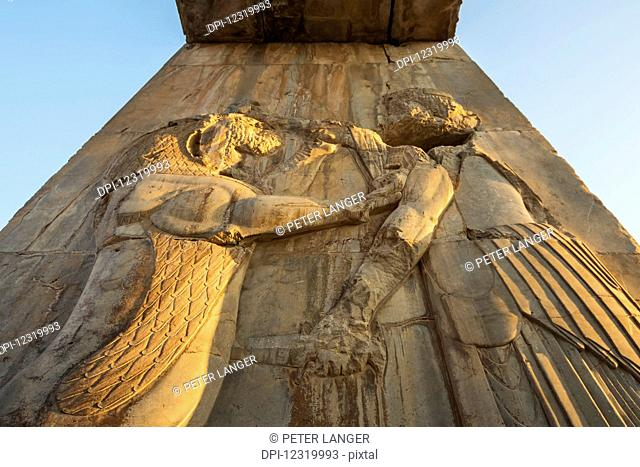 Bas-relief of the king fighting a lion on a gate of the Palace of Darius I (Tachara), Persepolis; Fars Province, Iran