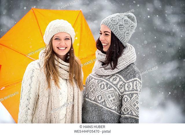 Two friends wearing knitwear in winter