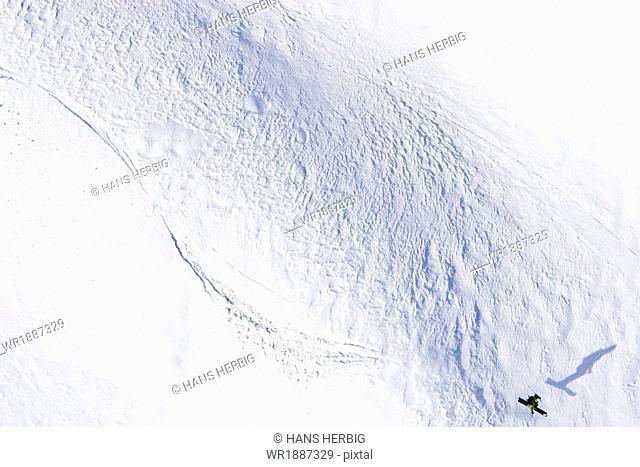 Snowboarder jumping, high angle view, Brandjochkreuz, Innsbruck, Austria