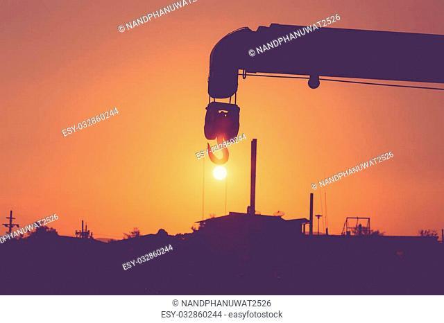 Silhouette of crane hook and sunset