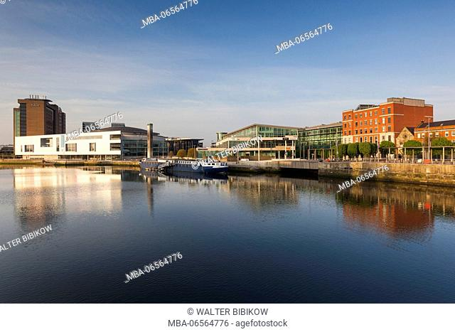 UK, Northern Ireland, Belfast, city skyline along River Lagan with Waterfront Hall, dawn