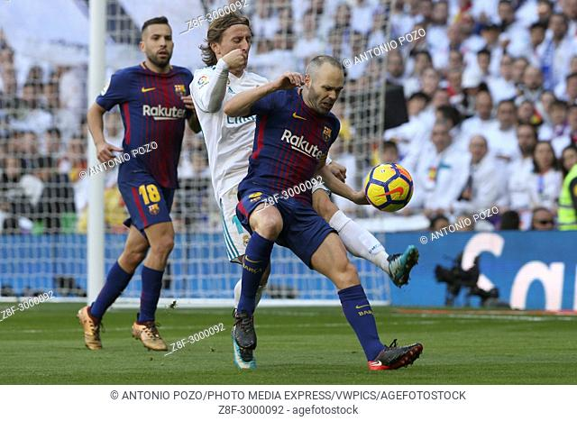 MADRID, SPAIN. December 23, 2017 - Andres Iniesta and Luka Modric. Real Madrid failed to close out the year by claiming victory in El Clasico at the Santiago...