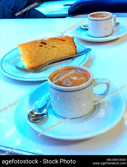 Two cups of coffee with sponge cake